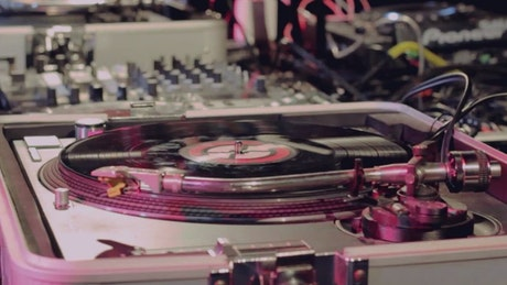 Dj playing and mixing music with vinyl