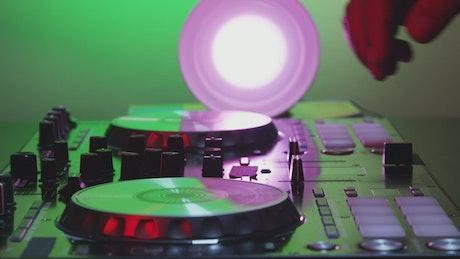 DJ using a mixer table