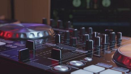 DJ using a mixer table at a party