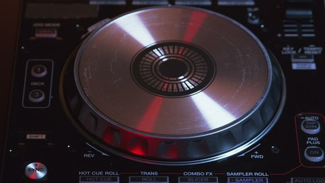 DJ using a turntable