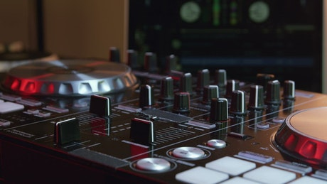 DJ using their equipment