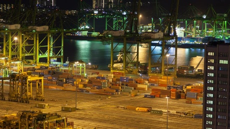 Docks of Singapore with shipping containers at night