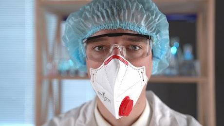 Doctor adjusting syringe liquid
