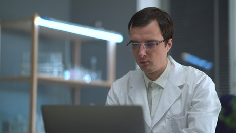 Doctor looking at x rays and the computer