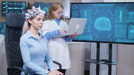 Doctor looks at patient brain scan on screen