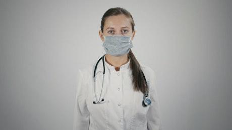 Doctor puts off a medical mask