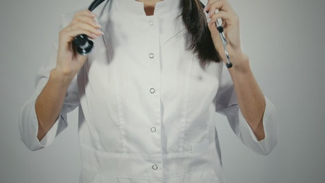 Doctor putting on a stethoscope