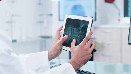 Doctor reviewing a scan on their tablet