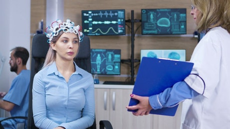 Doctor shows results of brain scan to patient