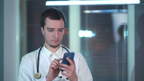 Doctor talking on the phone in an office