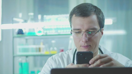 Doctor using a mobile phone in the lab