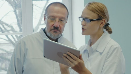 Doctor using a tablet to discuss treatments