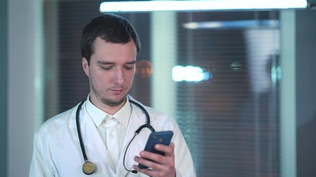 Doctor using phone in the hospital