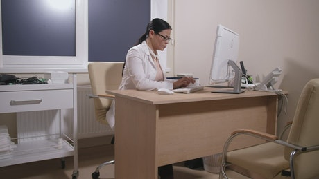 Doctor working in her office