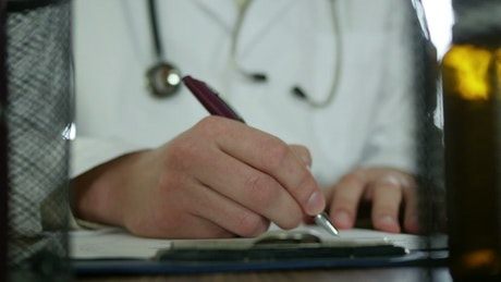 Doctor writing down a prescription