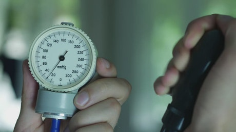 Doctor's hands measuring the pressure