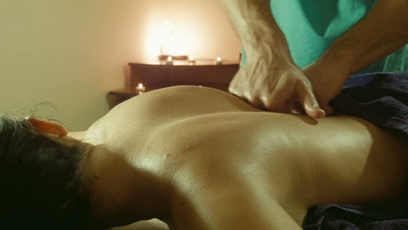 Doing a back massage in the spa
