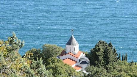 Dome of a church near the sea, from afar