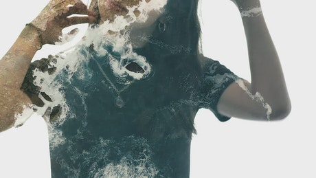 Double exposure video of a woman and a cliff in the sea