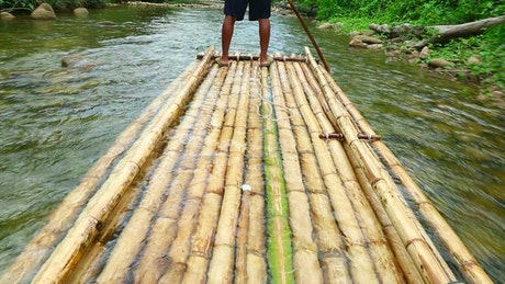 Down the river in a bamboo canoe