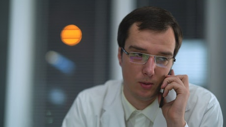Dr. talking on the phone