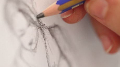 Drawing a woman on a canvas