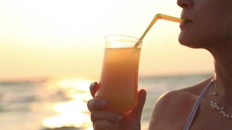 Drinking an orange cocktail