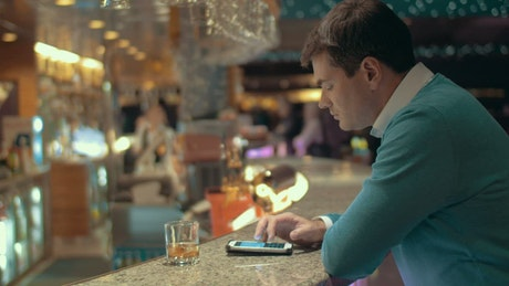 Drinking at the bar and texting