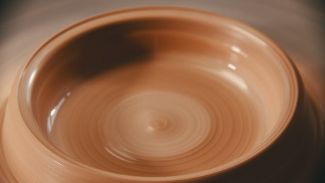 Dripping water into spinning clay