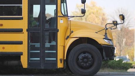Driver saying goodbye to school kids