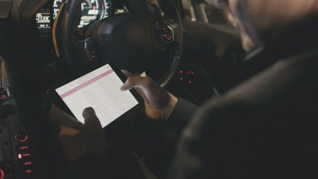 Driver using a tablet