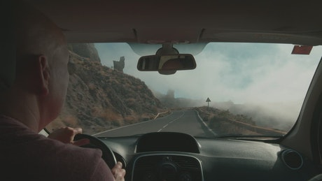 Driving along a volcanic road in Tenerife