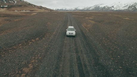 Driving an SUV past mountains