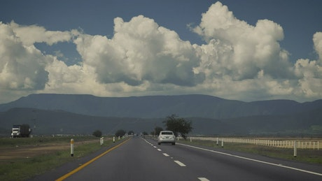 Driving on a freeway with mountains