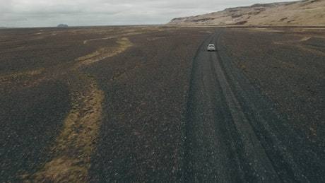 Driving over dark sand