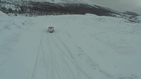 Driving up a snow covered mountain