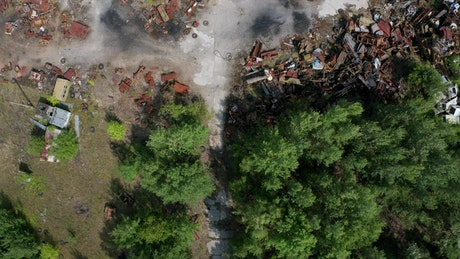 Drone flying above a rusty garbage site