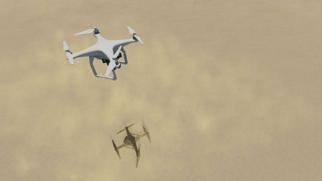 Drone flying above the sand of a sunny desert