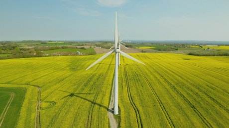 Drone flying above wind turbines