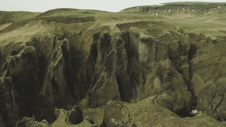 Drone flying across a canyon edge