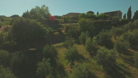 Drone flying across rural houses
