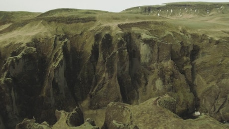 Drone flying along a canyon