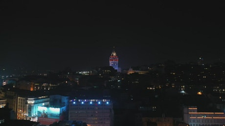 Drone flying around Galata Tower at night