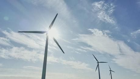 Drone flying around wind turbines