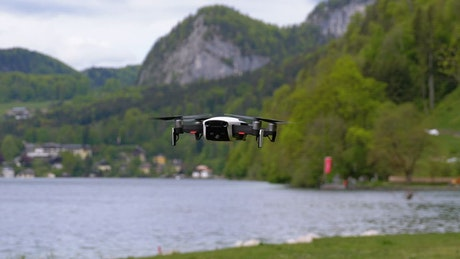 Drone flying near the lake