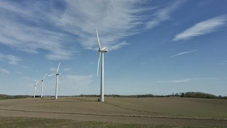Drone flying near wind turbines