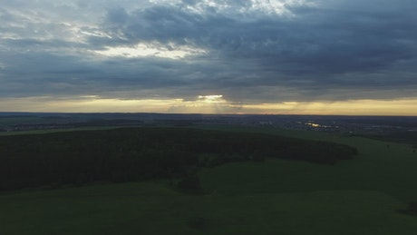 Drone flying over a field in the evening