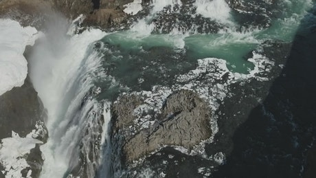 Drone flying over a waterfall