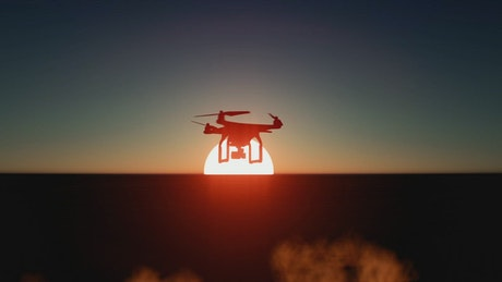 Drone flying over the sea during a sunset