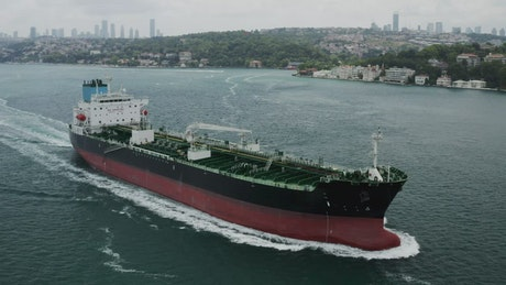 Drone flying past a cargo ship